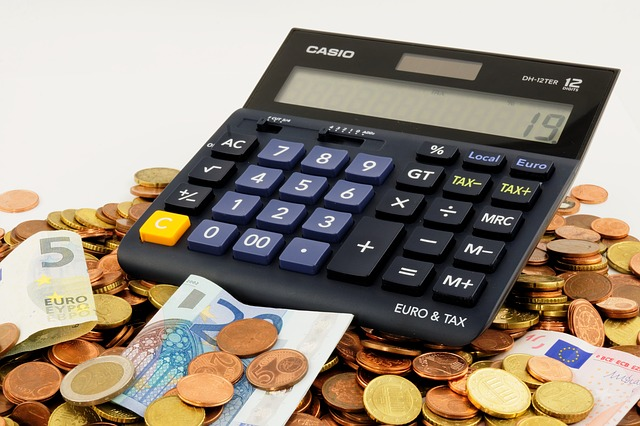 a calculator, some coins and banknotes because of thinking about how to cut moving costs