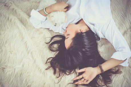 Girl and dog sleeping.