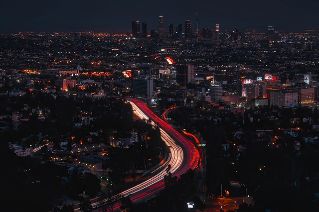 A skyline of Los Angeles at night.