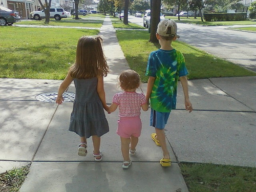 Kids holding each other by the hand