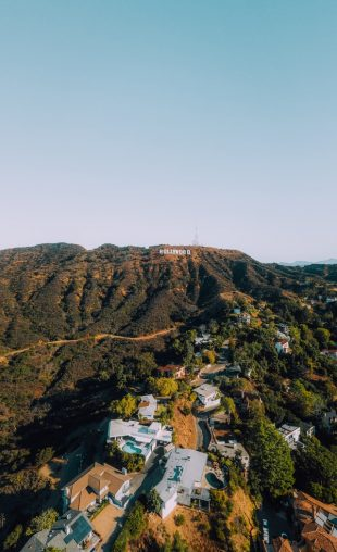 The Hollywood hill seen from a distance showing how LA has one of the best markets in real estate in the whole California.