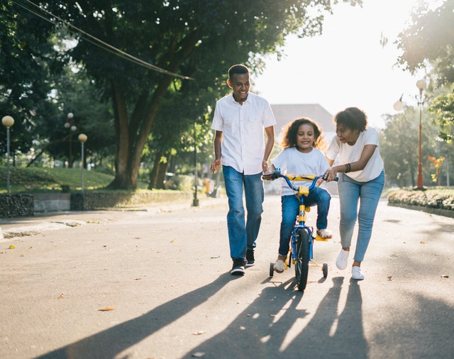 A child riding a bike after moving from LA to Washington DC with her family.
