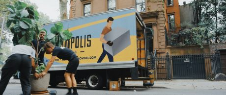 Professional movers loading items during the relocation to a great place to branch your office.