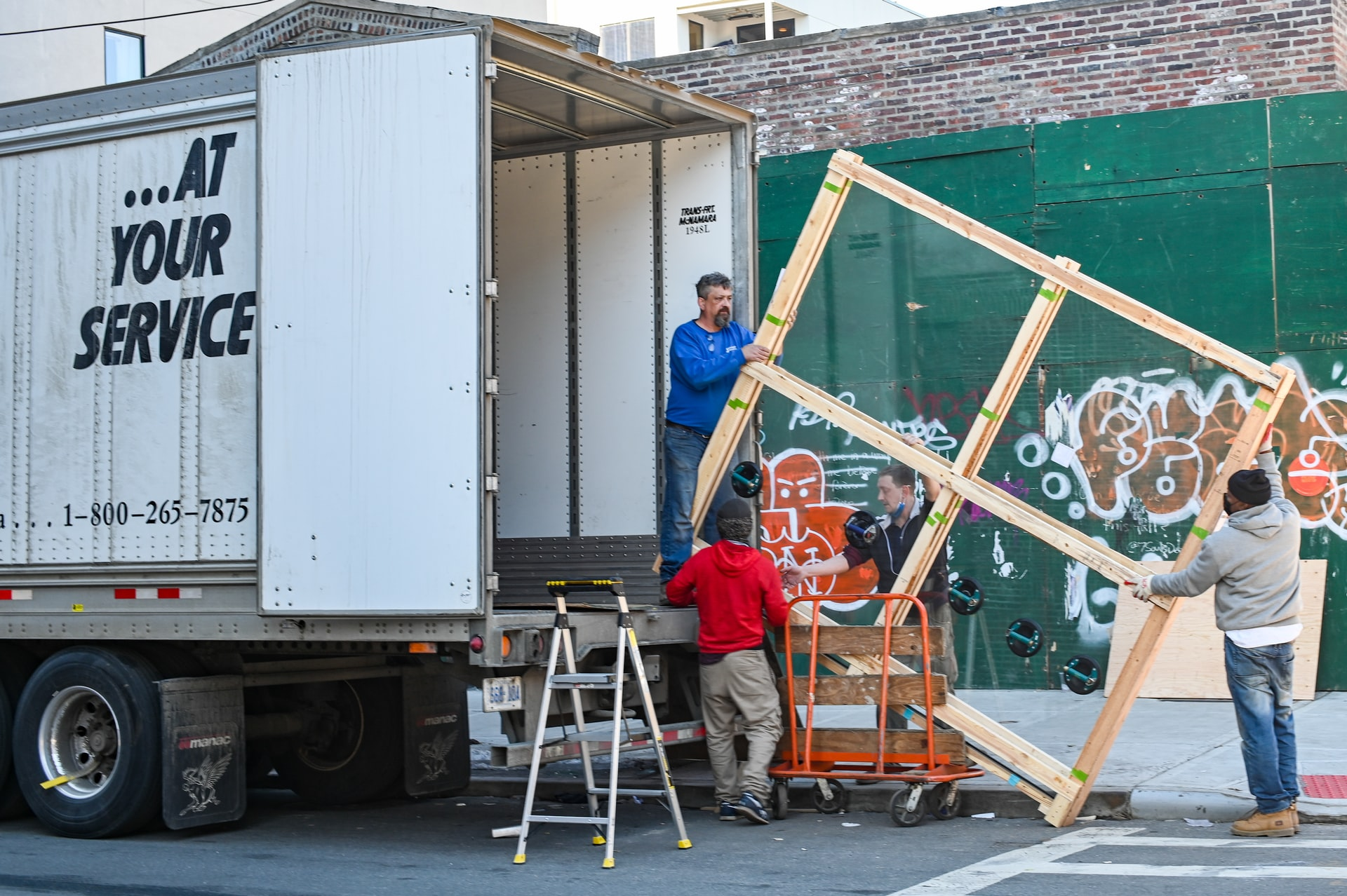 Movers loading the truck offer different types of moving services.