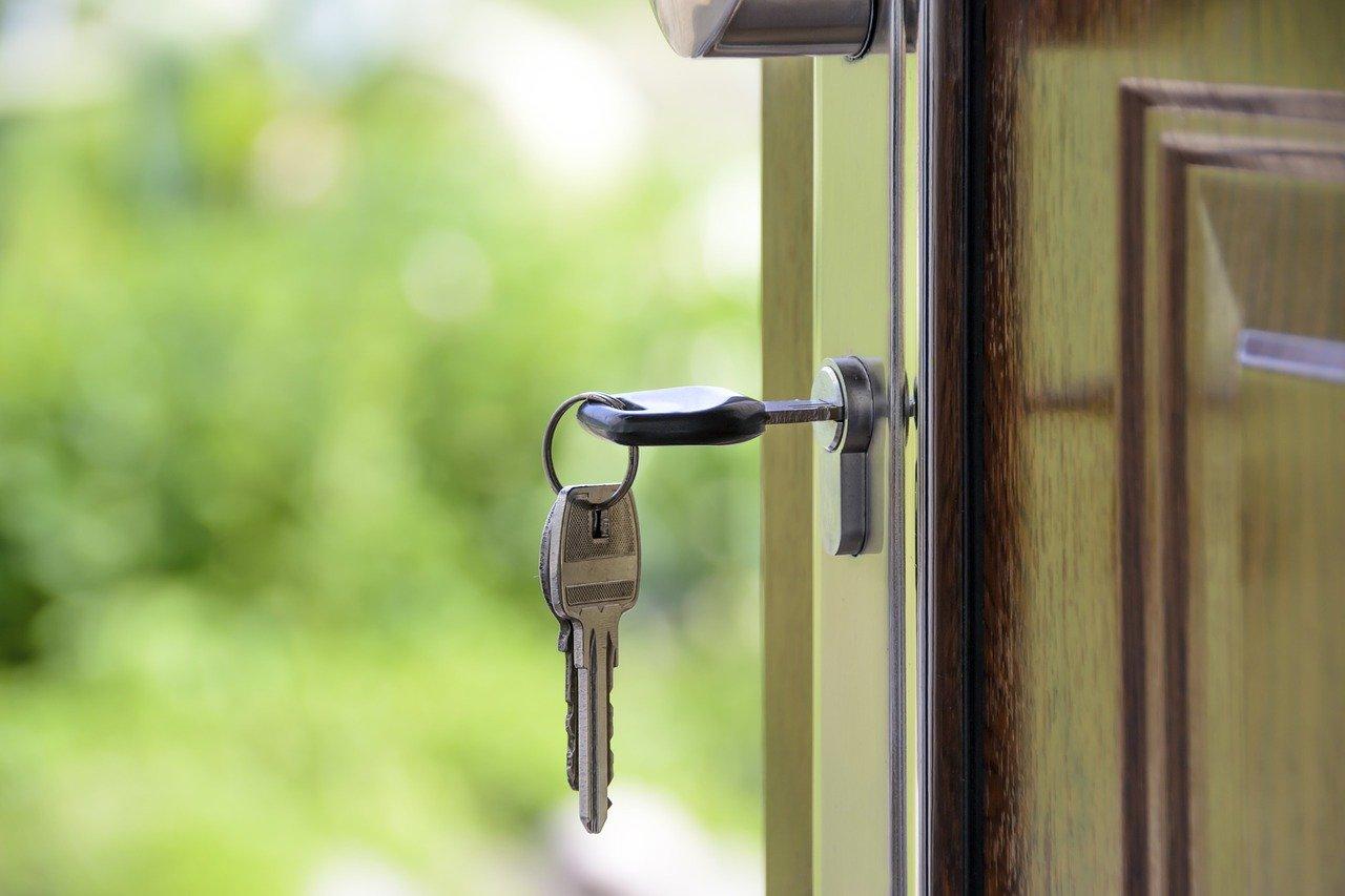 Keys in the lock of an open door.